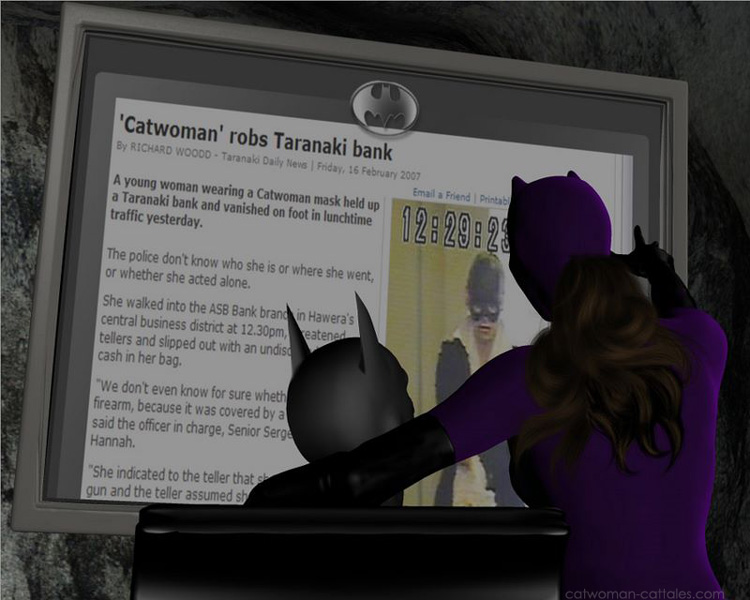 Batman and Catwoman consult a news account of a New Zealand bank robber wearing a Catwoman Mask